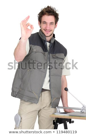 portrait of young tiler making okay sign Stock photo © photography33