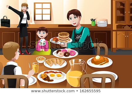 Smiling Boy Eating Pancakes With His Mother For Breakfast Stockfoto © Artisticco