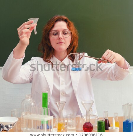 Portrait of a test tube filled in with a red liquid stock photo © wavebreak_media