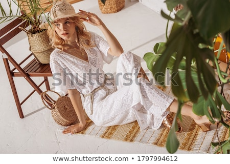 Elegant lady in a room full of fashion accessories stock photo © konradbak