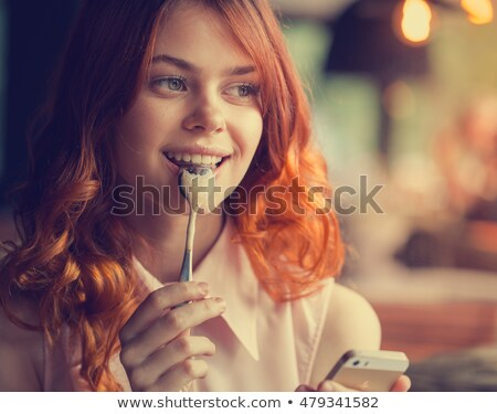 Woman licking phone. stock photo © iofoto
