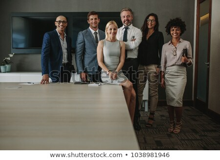 Group of multi ethnic business people posing and smiling Stock photo © HASLOO