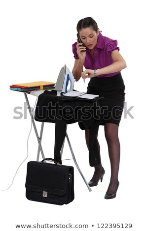 Late businesswoman ironing a suit jacket Stock photo © photography33