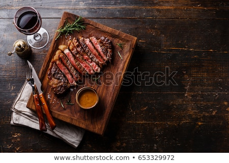 Rib Eye Steak served with wine stock photo © rohitseth