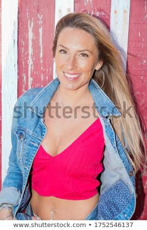 Beautiful and attractive female woman posing in blue jeans dress Stock photo © bartekwardziak
