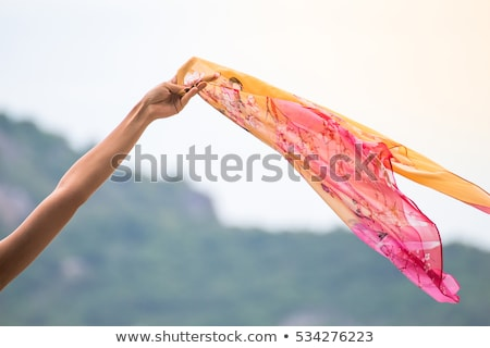 Stock photo: Woman with scarf feeling balanced