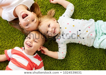 happy toddler laughing on floor stock photo © gewoldi