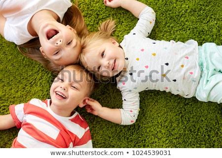 happy toddler laughing on floor Stock photo © gewoldi