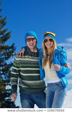 young couple on a sled in alpine snow scene stock photo © monkey_business