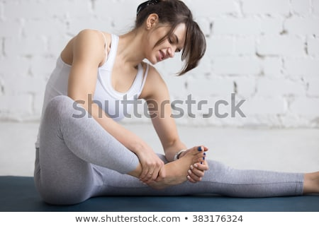 Beautiful young woman wincing in pain Stock photo © dash