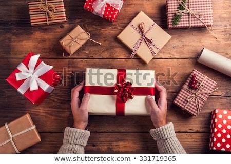 man hand with a christmas  gift Stock photo © marunga