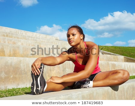 young african woman stretching her leg stock photo © hasloo