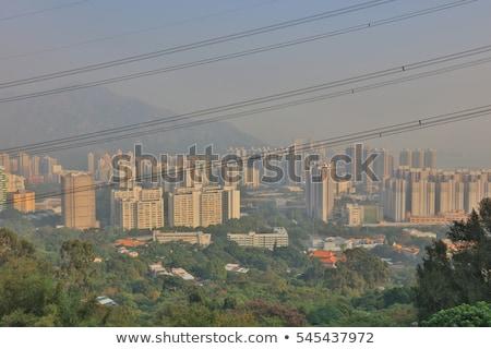 Kilátás Hongkong nap égbolt épület város Stock fotó © Elnur