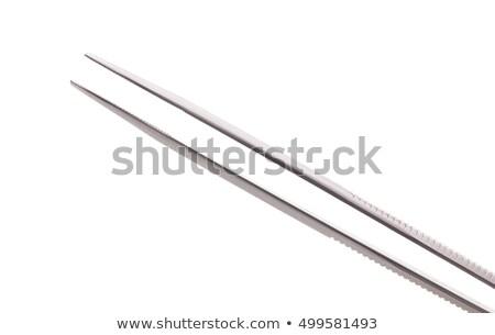 Pair of steel tweezers isolated Stock photo © ozaiachin