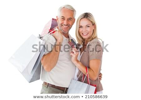 Volwassen paar glimlachend kaart witte Stockfoto © wavebreak_media