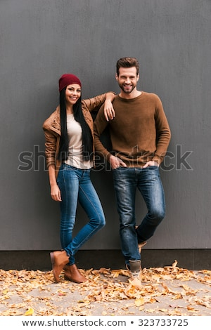 young fashion couple leaning on a wall. Stock photo © feedough