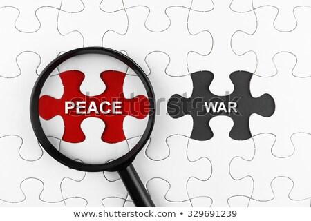 War - White Word on Blue Puzzles. Stock photo © tashatuvango