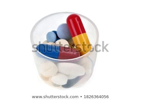 Miscela pillole primo piano bianco medici bottiglia Foto d'archivio © Mikko