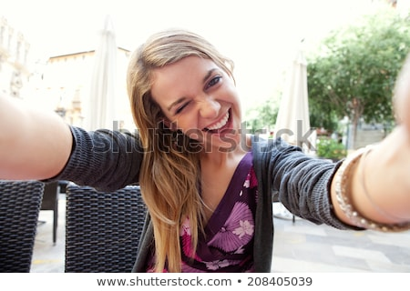 Portrait of a young woman winking Stock photo © deandrobot