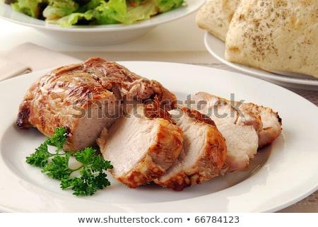 Roast pork tenderloin with bread roll Stock photo © Digifoodstock
