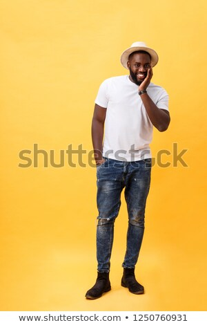 Full length portrait of a confident businessman looking away  Stock photo © deandrobot