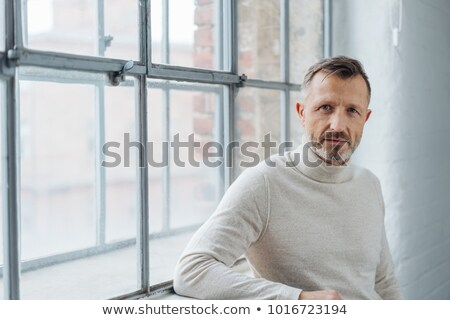 Pensive man looking at the camera stock photo © filipw
