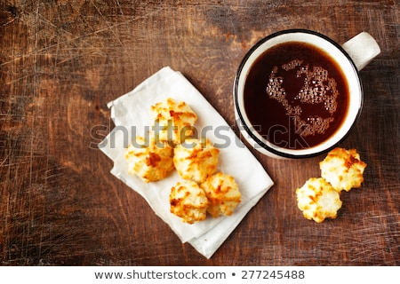 big cup of tea with tiny cookies on wooden table stock photo © dariazu