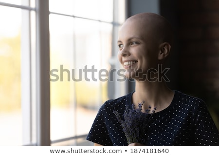 Young woman overcome when presented with a gift Stock photo © dash