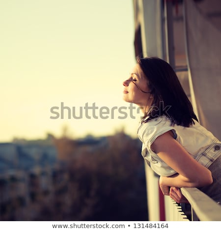 Stock photo: happy woman on the balcony