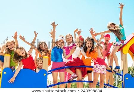 Bastante crianças recreio abaixo imagem grama Foto stock © deandrobot