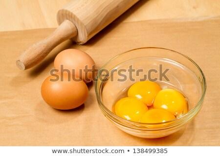Four fresh egg yolks Stock photo © Digifoodstock