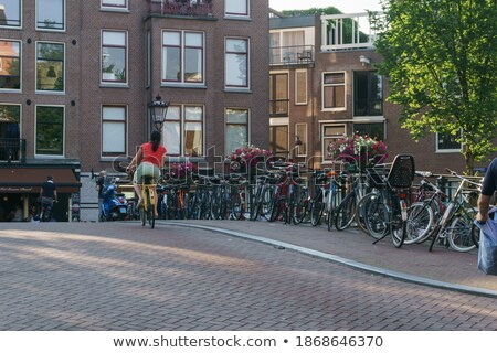 City cyclists, people riding bicycles on cobblestone road Stock photo © stevanovicigor