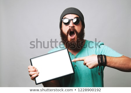 young man showing blank tablet computer screen stock photo © deandrobot