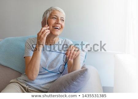 senior · mulher · telefone · móvel · branco · negócio · sorrir - foto stock © wavebreak_media