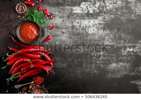 辛い 唐辛子 ソース ケチャップ 背景 黒 ストックフォト © yelenayemchuk