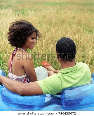 Casal sessão soprar para cima sofá fora Foto stock © IS2