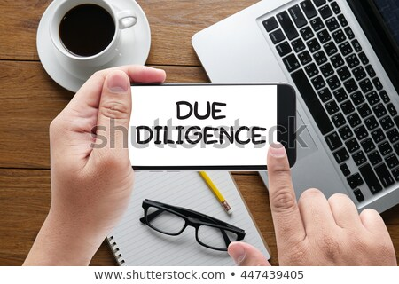 Hand Touching Due Diligence Key. Stock photo © tashatuvango