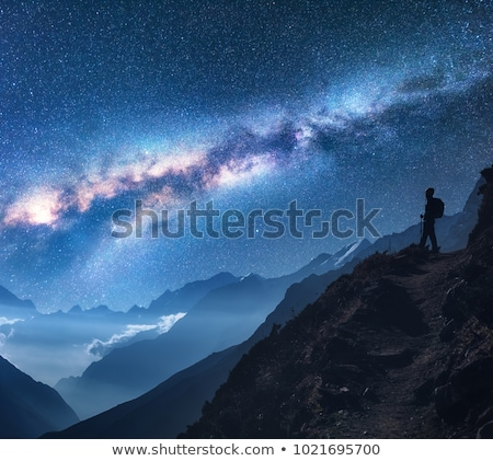 Space with Milky Way, girl and mountains at night Stock photo © denbelitsky