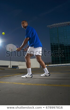 Tennis player on rooftop court Stock photo © IS2