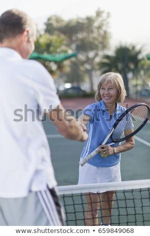 Idősebb pár áll teniszpálya szeretet portré Stock fotó © IS2