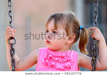 Portrait of a smiling playful girl looking away Stock photo © deandrobot