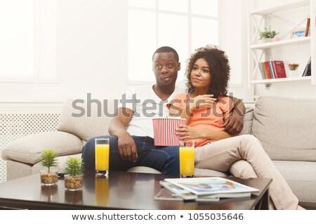 Homem sopa controle remoto alimentação colher masculino Foto stock © IS2
