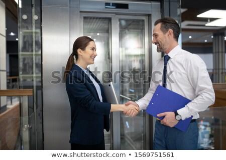 Biznesmenów drżenie rąk czeka windy biuro człowiek Zdjęcia stock © wavebreak_media