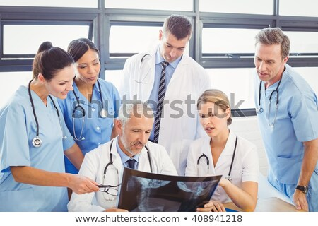 Female doctor examining x-ray report Stock photo © wavebreak_media