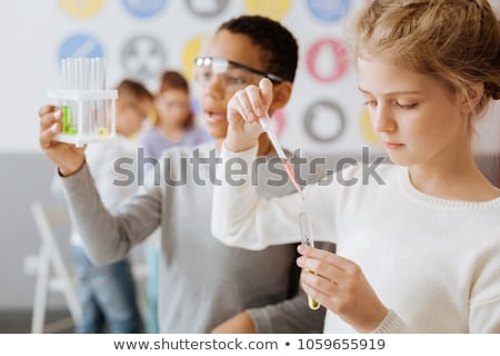 iskolás · gyerekek · tanár · tudomány · osztály · nő · iskola - stock fotó © monkey_business