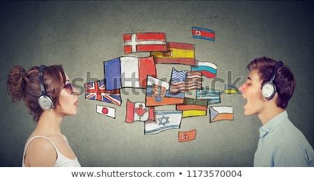 Fiatal nő fejhallgató tanul különböző nyelvek okostelefon Stock fotó © ichiosea