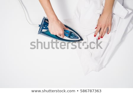 Woman Ironing Clothes With Electric Iron Stock photo © AndreyPopov