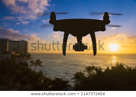 Silhouette of Unmanned Aircraft System (UAV) Quadcopter Drone In Stock photo © feverpitch