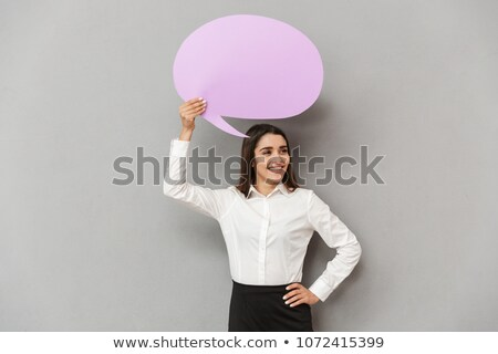 Photo of joyous woman in white shirt and black skirt looking asi Stock photo © deandrobot