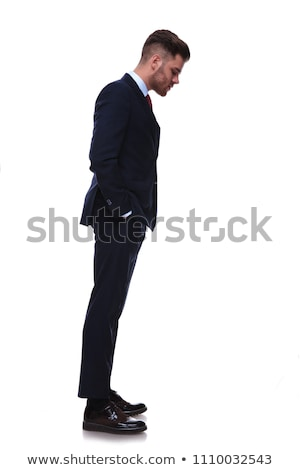 businessman waiting in line and looking down at something Stock photo © feedough